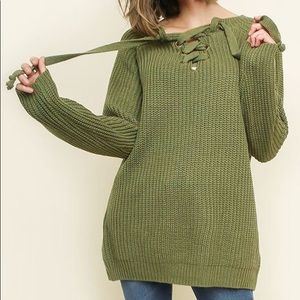 Long sleeve knit pullover sweater.